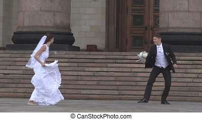 The bride and groom jump in ballet