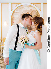 the bride and groom kiss in the registry office - the bride...