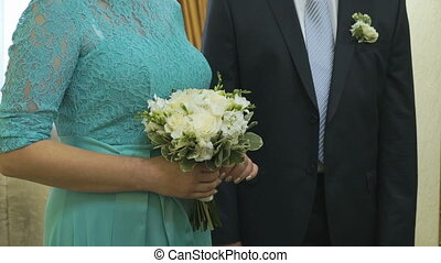 The bride and groom standing in the wedding hall in day of...