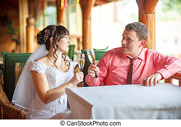 the bride and groom with champagne glasses