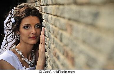 The bride at a wall