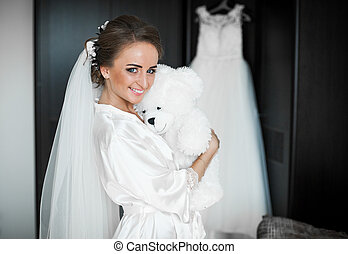 The bride embraces her toy