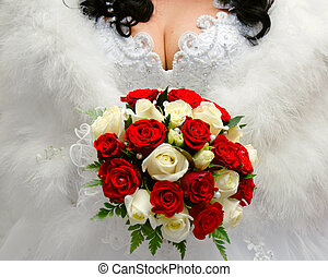the bride holding a wedding bouquet