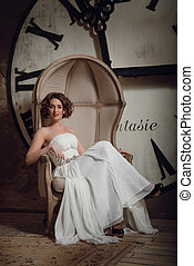 The bride in a chair with fireplace