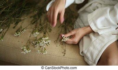 The bride in a white hotel gown wove wreath gypsophila