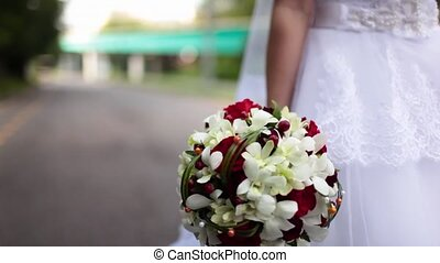 the bride in carrying the Bridal bouquet