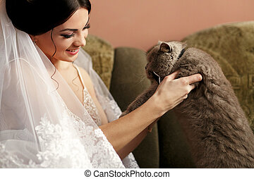 The bride keeps her cat