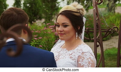 The bride looks at the groom