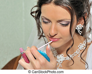 The bride making up