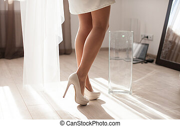 The bride stands near vase
