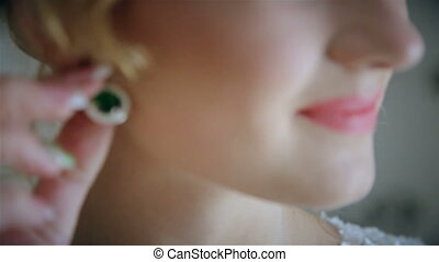 The bride wears a wedding earring