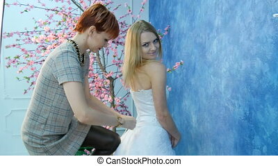 The bride wears a white dress