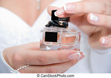 The bride with a bottle of perfume