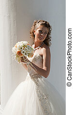 The bride with a bouquet.