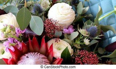 The bride's bouquet. Wedding bouquet. Bouquet of different flowers. Bridal bouquet