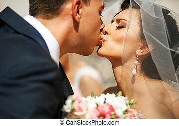 The brides kissing