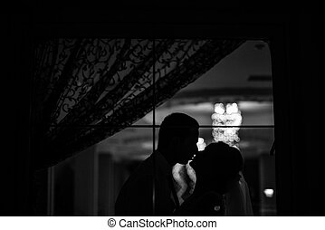 The brides stands near window