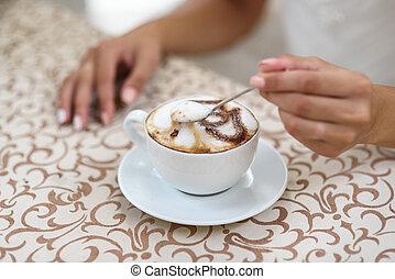 the bride's stirring a cappuccino