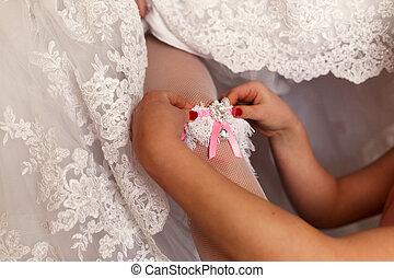 The bridesmaid helps to bride