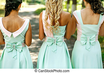 The bridesmaids with bouquet