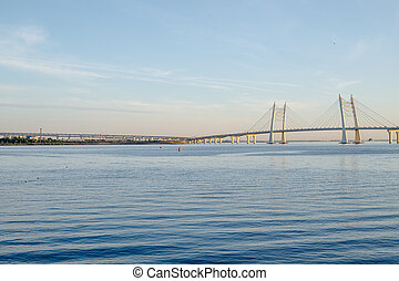 The bridge in St. Petersburg. Beautiful view of the Gulf of Finland, St. Petersburg, Russia, big river view. Krestovsky Island. Neva River. Bridge leading to the highway. western high-speed diameter