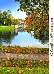 The bridge over a reservoir in autumn park