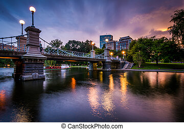 The bridge over the lake at the Public Garden at sunset, in Boston, Massachusetts.