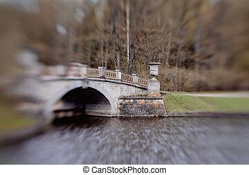 The bridge over the river Slavyanka in Pavlovsk park in the...