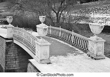 The bridge through the river the Slav in Pavlovsk park.