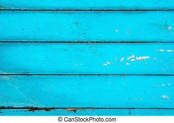 The bright blue textured wooden background, top view.