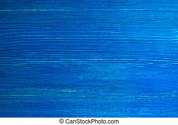 The bright painted blue wooden textured background. Colorful background.