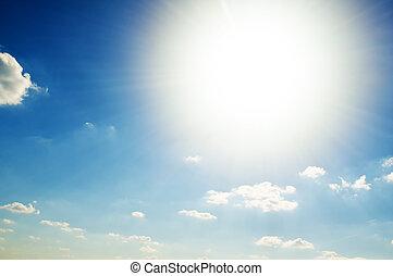the bright sun in the blue sky