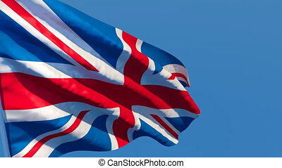 The British national flag is flying in the wind