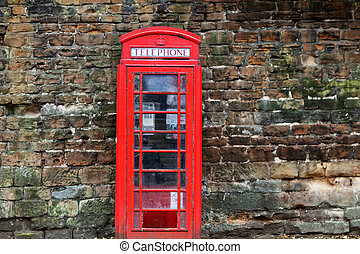 The British red phone booth on old wall