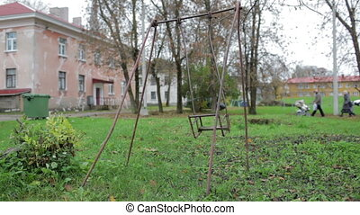 The broken child's swing. Unhappy childhood concept.