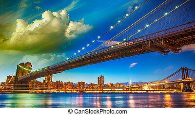 The Brooklyn Bridge Park, New York. Manhattan skyline at summer sunset.