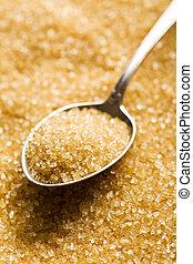 the brown sugar in silver spoon