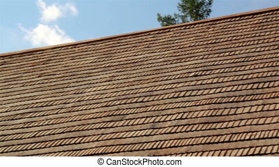 The brown tar oiled wooden shingle shake roof of a big house...