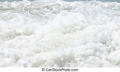 The bubbling of the water (boiling water, whitewater) accompanied by a multitude of flying droplets and foam, stochastic motion