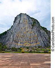 Buddha image on the mountain