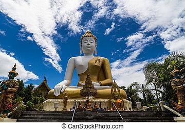 The buddha status on blue sky background