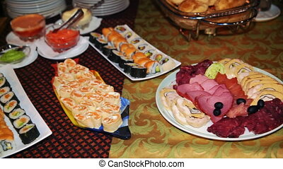 the buffet, dishes of food are on the table