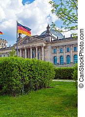 The building of the German Parliament the Reichstag and the flag in Berlin, Germany