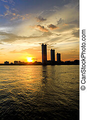 The buildings and sunset on the river at Bangkok