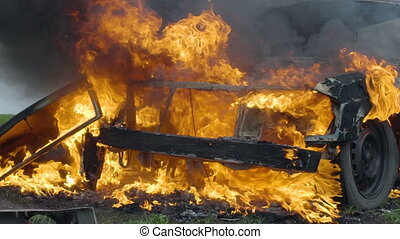 The burning car is in the field, the blown up car is on...