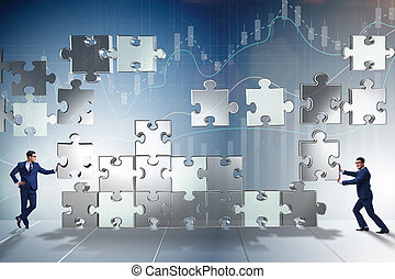 The business concept of teamwork with puzzle pieces