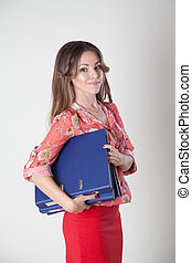 the business Secretary in an Office with folders securities documents