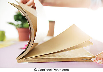The business woman in the workplace flips through the dailybook
