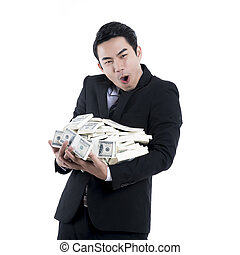 The Businessman holding a big pile of money in his arms on white background
