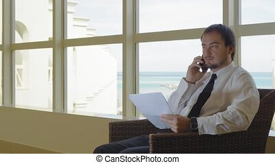 The businessman in the lobby working with documents